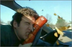 A distracted driver's face is thrown against a Doritos bag after he checks out an attractive woman.