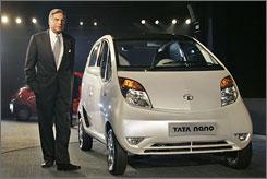 Tata Chairman Ratan Tata beside the $2,500, 50 mpg Nano at a New Delhi ceremony on Thursday.