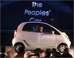 Ratan Tata, chairman of the Tata Group, in the new Tata Nano at its unveiling in New Delhi last week.