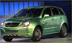 "A Saturn Vue plug-in hybrid with a gas-free limit of some 10 miles could arrive ""as soon as 2010."""