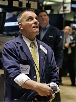 Trader Albert Young watches the numbers at the New York Stock Exchange on Wednesday.