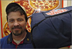 Domino's says that its online tracking system is accurate to within 40 seconds. (Here, Domino's driver Jim Pohle at a Florida store in 2006.)