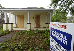 An Atlanta home in foreclosure. Many facing mortgage trouble don't seek help, a survey says.
