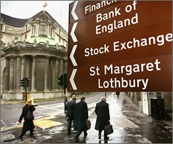 People walk by the Bank of London in this 2004 photo. Economist Roger Bootle says Britain follows U.S. trends and is at risk of falling into a recession.