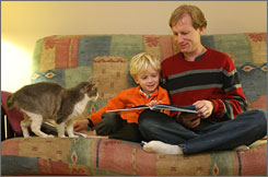 Benjamin Goldberg, 6, reads with his father, Richard. Benjamin was sickened by too-strong dosages of amoxicillin from a pharmacy in 2001.