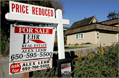 A for-sale sign outside a home in San Carlos, Calif.