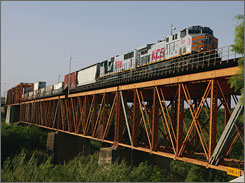 A Kansas City Southern train crosses the International Bridge in Texas. The rail line is the smallest of North America's seven major railroads.