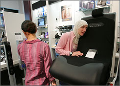 Nadia Gerban of Philadelphia checks out a Pyramat Sound Rocker last year at a Sharper Image in King of Prussia, Pa.