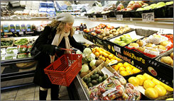 Emily Whipple of Boston selects her produce at the Golden Goose Market in Boston.