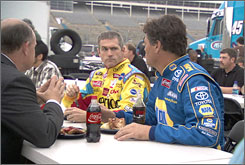 An actor playing a Coca-Cola manager pitches a commercial spot to NASCAR's Bobby Labonte, center, and Michael Waltrip.