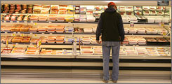 A customer looks over packaged meat in a Virginia grocery store in this file photo. Beef and veal prices rose 3.6% in January.