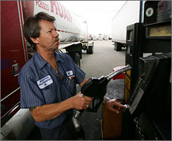 "Bill McMahon fills his rig with diesel at $3.89 a gallon last week in California. The Fed says rising fuel costs ""continue to plague"" the trucking industry."