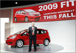 Honda's Dick Colliver unveils the 2009 Fit, one of many car debuts at the New York auto show.