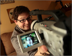 Brandon Hardesty holds the video camera he uses in his basement where he films all of his videos which he places up on YouTube.