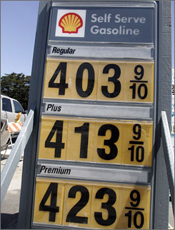 Gas prices are displayed April 11 at a station in Half Moon Bay, Calif. Despite high prices, carmakers are increasingly recommending premium gas.