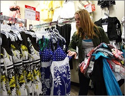 "Brielle Sullivan, 13, of Warwick, N.Y., shops at J.C. Penney in Paramus, N.J. Brielle's mother Lisa lauds J.C. Penney's for its ""more reasonable prices."""