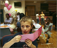 Gabriel Wilkerson, 6, records a Mother's Day greeting for his mother during the Hallmark Cards' Military Support Day at Fort Bliss, Texas.