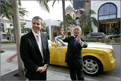 "Rolls-Royce motor Cars' U.S. President Paul Ferraiolo, left, with Bijan Pakzad and his custom-colored ""Bijan yellow"" Rolls-Royce Drophead Coupe parked in front of Pakzad's Bijan boutique on Rodeo Drive in Beverly Hills."
