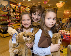 Build-A-Bear Workshop's Maxine Clark with scouts Brea Griffonetti, left, and Cameren Agosta at the Galleria Build-A-Bear in St. Louis. Clark founded the company in 1997 and remains CEO.
