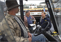 Truckee-Tahoe Lumber Vice President Steve Stevenson, right, talks with driver Rob Scott, middle, and Chris Toreson at the yard in Truckee, Calif.