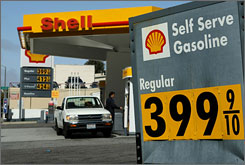 Gas prices are displayed at a Shell station May 5 in San Francisco. Some areas have already passed the peak price for gasoline that was just forecast.