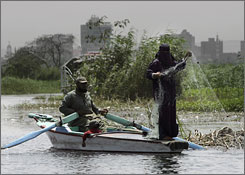 An Egyptian family fishes on the Nile River near Cairo. The country has the earmarks of a gathering boom, but many Egyptians aren't a part of it.