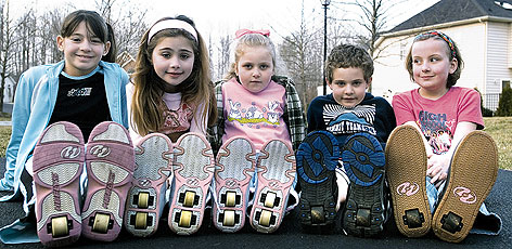 A Heelys exec expects that its wheeled shoes -- here modeled last year by kids in their Edgewater, Md., neighborhood -- will account for just 30% to 35% of sales in five years.