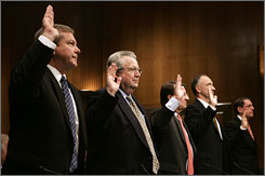 From left: BP America Chairman Robert Malone, Shell Oil President John Hofmeister, Chevron Vice Chairman Peter Robertson, ConocoPhillips Executive Vice President John Lowe and ExxonMobil Senior Vice President J. Stephen Simon are sworn in.