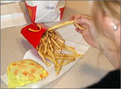 McDonald's says its french fries are now trans-fat-free in all of its restaurants in the U.S. and Canada.