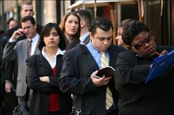 People wait in line to enter a job fair in New York.