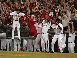 Dustin Pedroia hits a home run in the seventh as the Red Sox play the Cleveland Indians in Game 7 of the American League Championship Series. The photograph is part of a display of Boston photojournalists' work at Logan Airport.