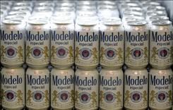 Cans of Modelo beer are seen in a store in Mexico City. CEO of Grupo Modelo resigned from the Anheuser-Busch board, which owns half the Mexican-based brewery.  Fernandez's departure may be a signal that the Anheuser-Busch board is opposed to the InBev deal.