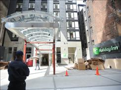 Daniel Gedna does security duty at a Holiday Inn in New York City. The hotel opens this week.