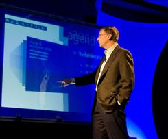 At the CEO Summit in May, Microsoft's Bill Gates demonstrates the TouchWall, a prototype user interface technology with a touch-sensitive surface.