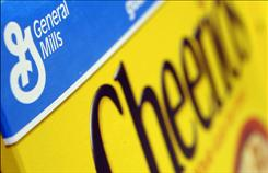 General Mills said costs for hedging commodities drove its fourth-quarter profit down 17 percent, but strong sales of yogurt, cookie mixes and Cheerios boosted revenue above Wall Street expectations.