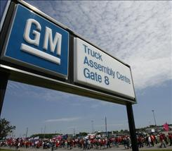 Thousands of Canadian Auto Workers union members march outside the GM assembly complex in Oshawa, Ontario, June 12. The workers were protesting GM's decision to close the truck plant in 2009.