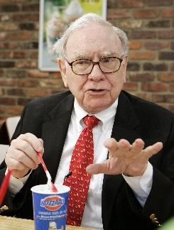 Warren Buffett samples a Girl Scout Thin Mint Cookie Blizzard at a Dairy Queen in Omaha.