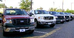 Ford pickups are seen on a dealership lot in Fairfax, Va. Skyrocketing gasoline prices and a weakened economy continue to cause problems for auto manufacturers. 