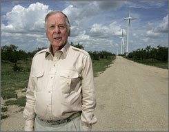 Financier T. Boone Pickens in Sweetwater, Texas, with wind turbines in the background.