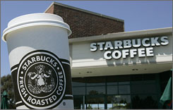 Starbucks is testing different promotions including  vouchers and discounts to help boost store traffic.