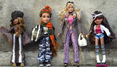 Bratz dolls surround a Barbie in a Dream Toys 2004 exhibition.