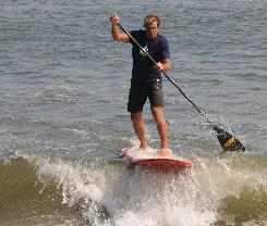 Laird Hamilton demonstrates stand-up paddling with a Laird Paddle Surf paddle on the waves at Malibu.