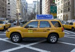 NYC taxi drivers are supposed to shift to hybrids, like this Ford Escape, when an Oct. 1 mandate kicks in.