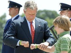President Bush fist bumps with Robbie Powell in Little Rock. Robbie gave Bush a green bracelet in memory of a friend who died of a rare disease.