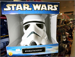 An official 'Star Wars' replica stormtrooper helmet is pictured in a fantasy memorabilia store in London, on July 31, 2008. Makers of the 'Star Wars' movies are seeking to stop prop designer Andrew Ainsworth, who made the first helmets and suits for the original 1977 film, from marketing copies of costumes.