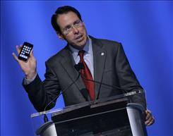AT&T chief Randall Stephenson with the iPhone 3G at a Las Vegas convention in June. The device is key to AT&T's ongoing transformation, he says.