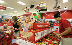 Fall prep: Stephanie Simon works on a back-to-school display at a Target in Tallahassee.