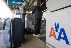American Airlines currently charges $15 for the first checked bag.