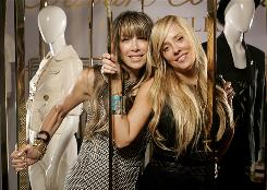 Juicy Couture co-founders Gela Nash-Taylor, left, and Pamela Skaist-Levy in their Rodeo Drive store.