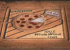 "Denver International Airport passengers will be greeted by a Papa John's ""crop circle."""